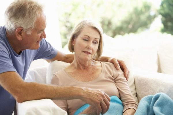 41461822 - husband comforting senior woman feeling unwell resting under blanket