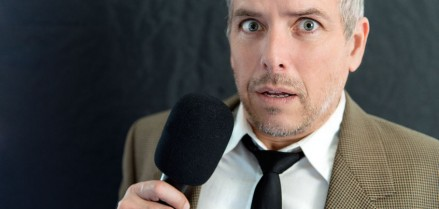 45857485 - close-up of an anxious man speaking into microphone.