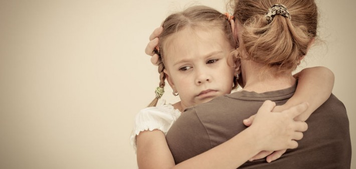 27421952 - sad daughter hugging his mother