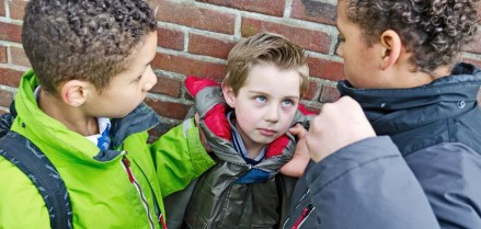 18519601 - two boys bullying little kid